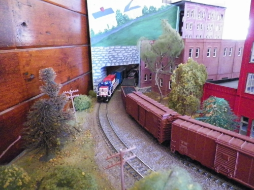 The HO scale model railroad layout was a big hit with visitors. Mal Sockol and Richard Nichols put the layout into top form ahead of the Folk Festival. Richard Nichols photo.