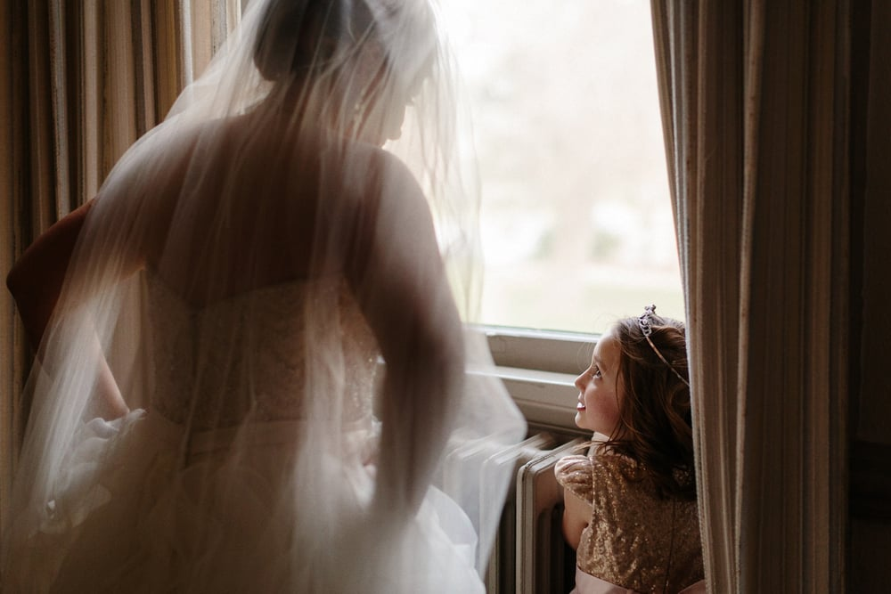 015-bride-and-flower-girl-at-window.jpg