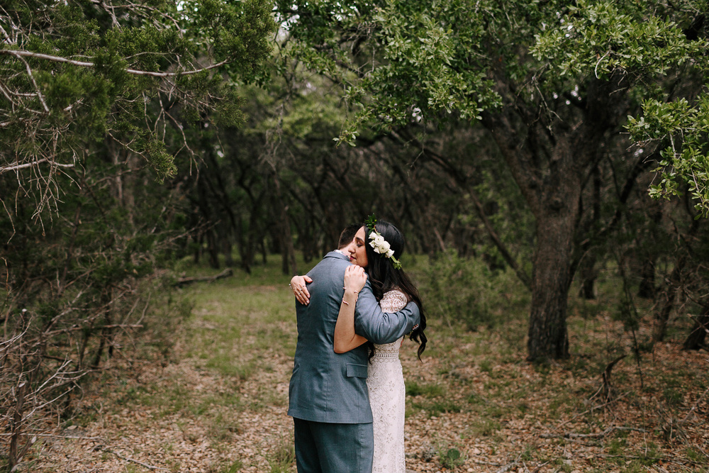 Blue Hole Regional Park Bride and Groom Embracing in Forest