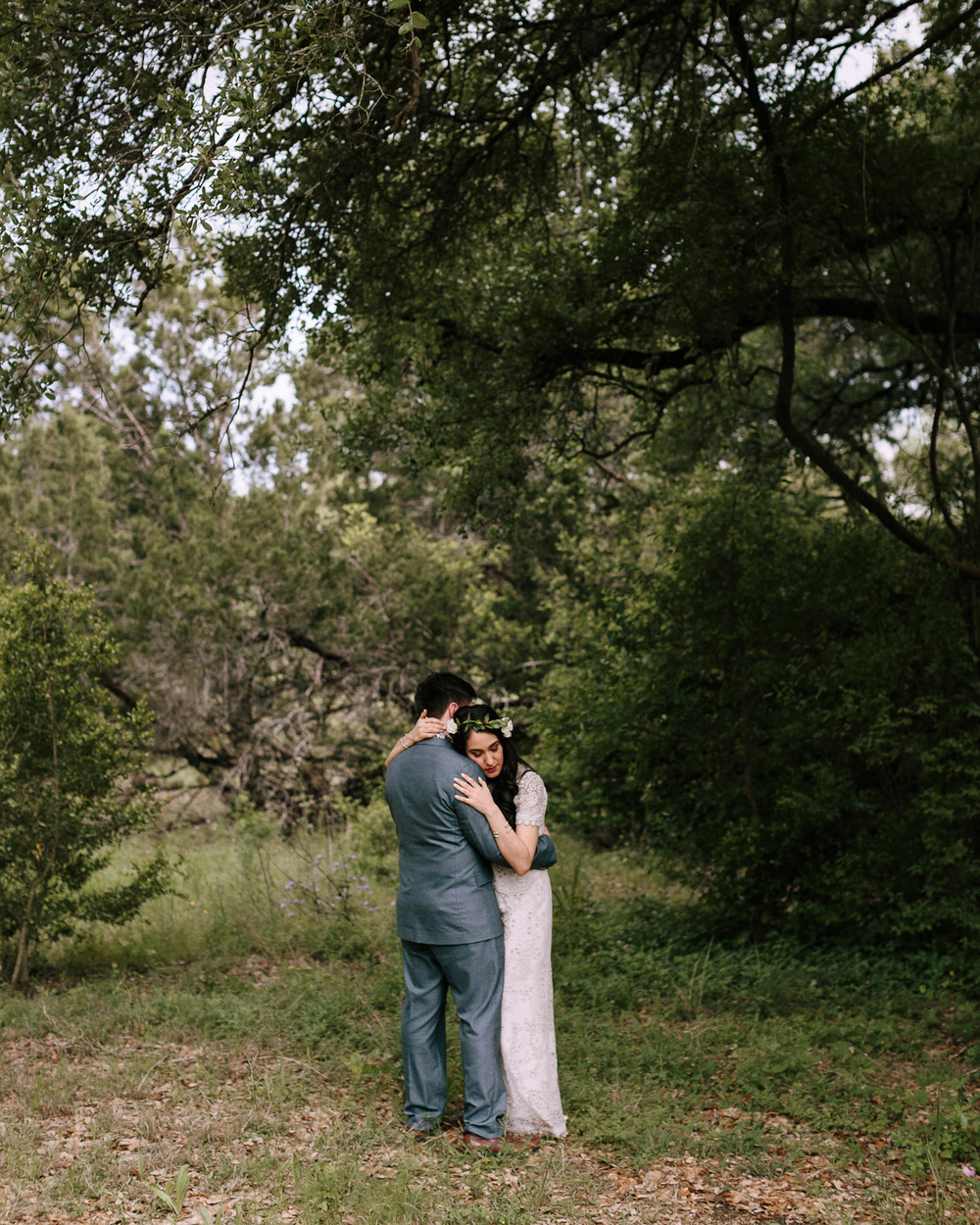 Wimberley Texas Backyard Wedding Bride and Groom Embracing in Forest