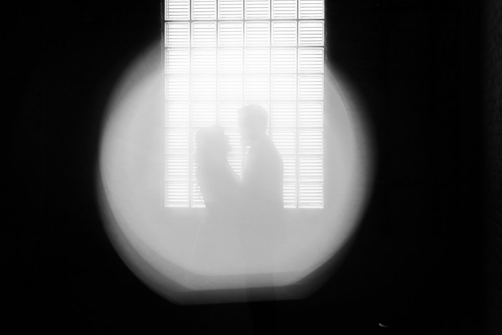 Studios at Overland Crossing Wedding Bride and Groom Window Portrait