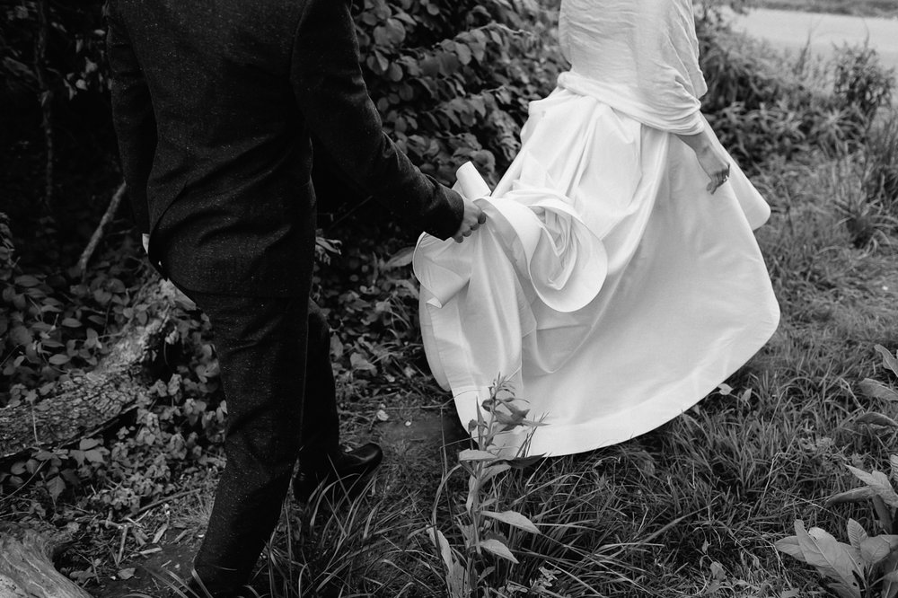 Bride and groom walking with dress black and white