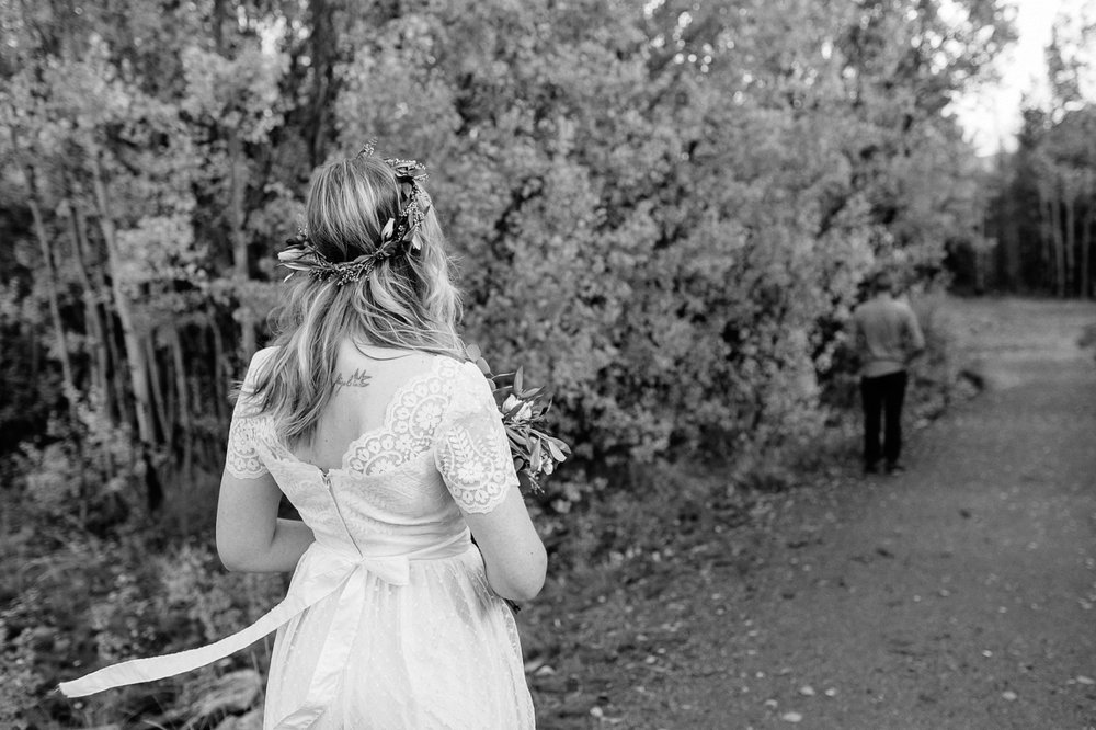 Bride walking towards groom