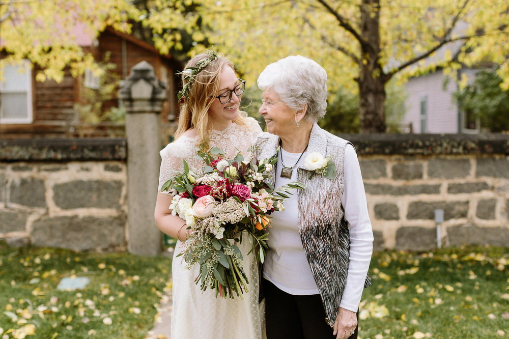 Bride laughing with her grandmother