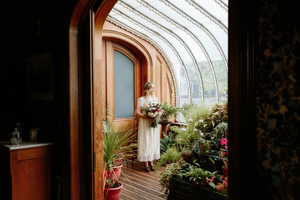 Hamill House bride in conservatory with flowers