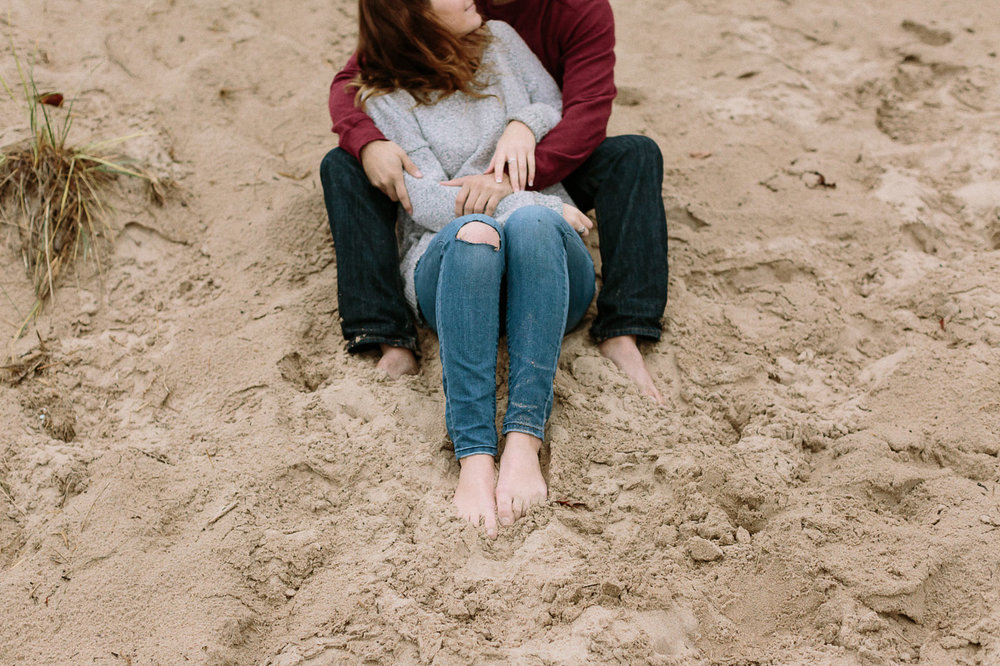Couple's feet in sand