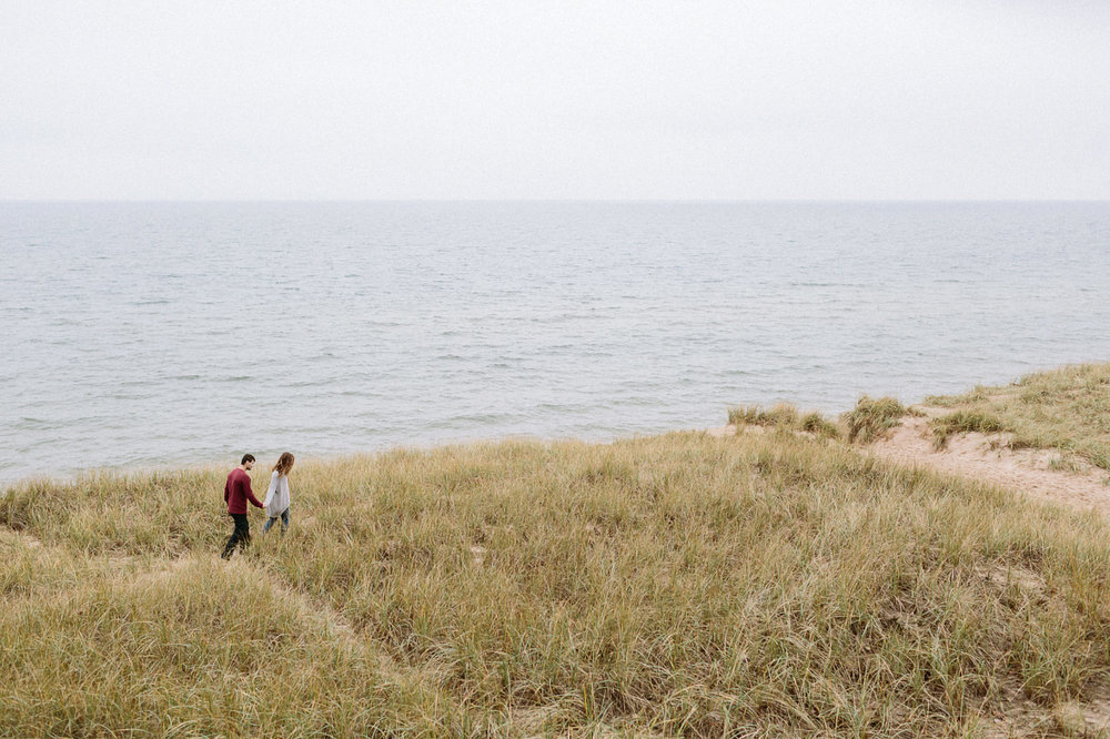 Couple walking at Saugatuck Dunes State Park