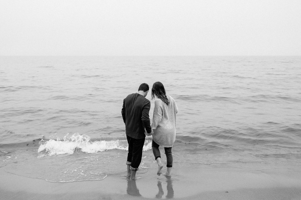 Couple walking into the waves