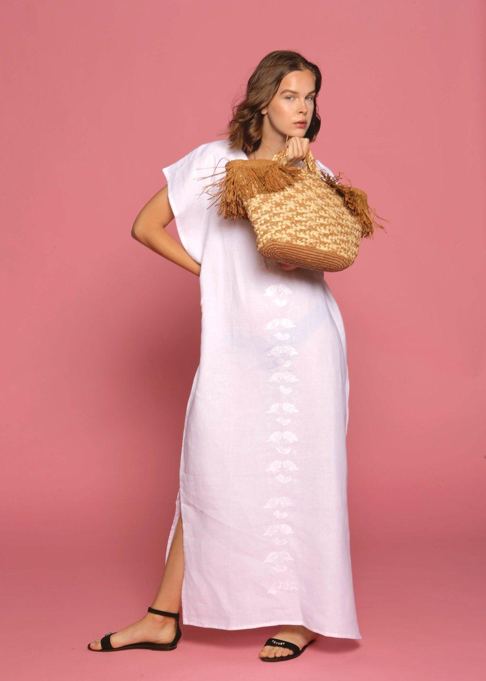 linin kaftan and woven beach bag.jpeg