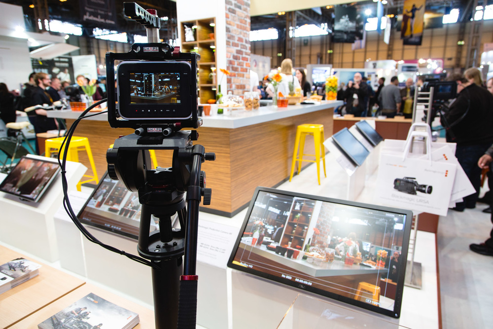 Blackmagic's cameras on display. They had set up a restaurant scene with cameras connected to large screens to play with.