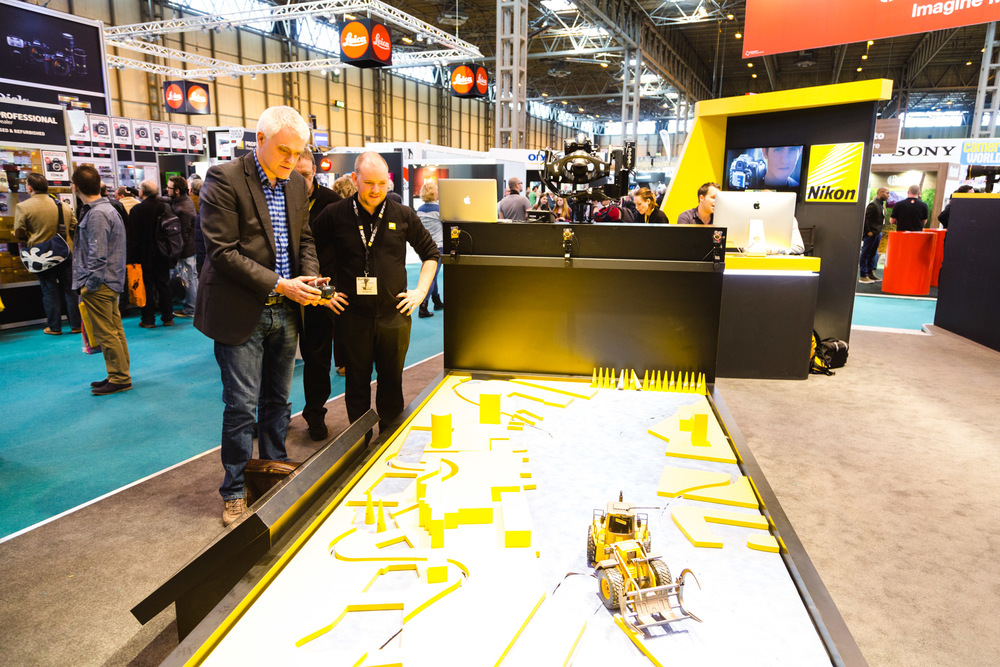 Jon Bentley from The Gadget Show trying new technology developed with MRMC at the Nikon stand. The idea is for a small tracking ball to be placed on tv presenters for cameras to follow for television.