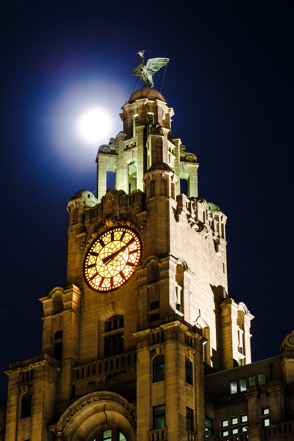 The Supermoon moving behind the Royal Liver Building