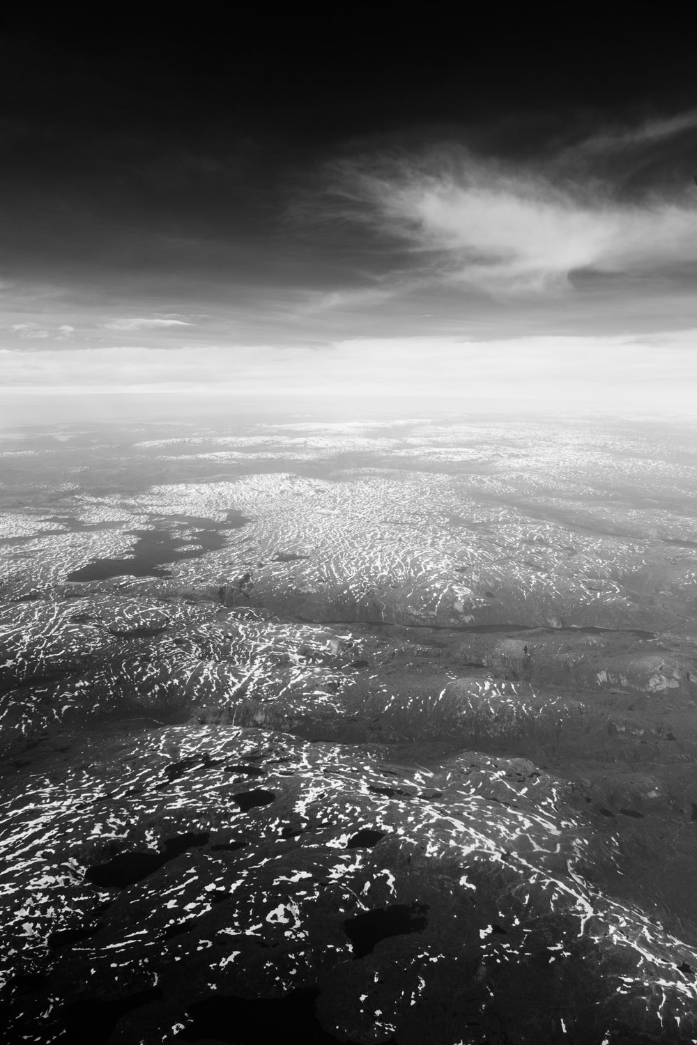 Flying over snow-patched Norwegian mountains as we approach Oslo.