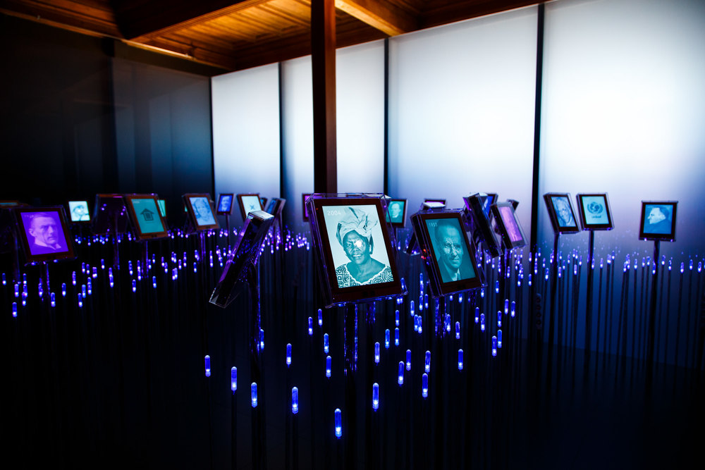 Photos of Prize winners illuminate this room through animated screens.