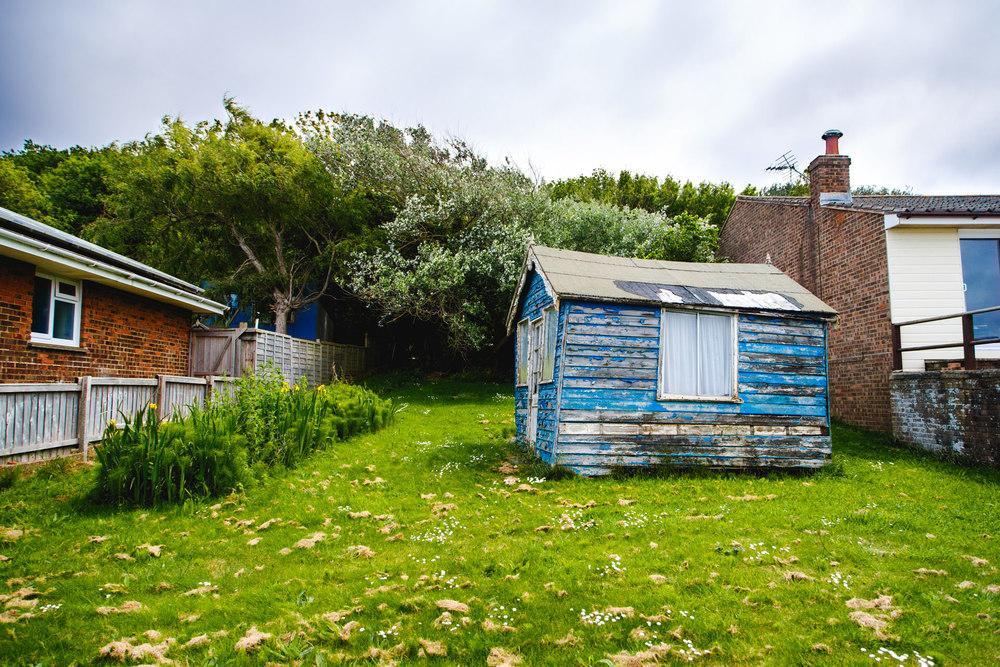 A weary shed in someone's garden.