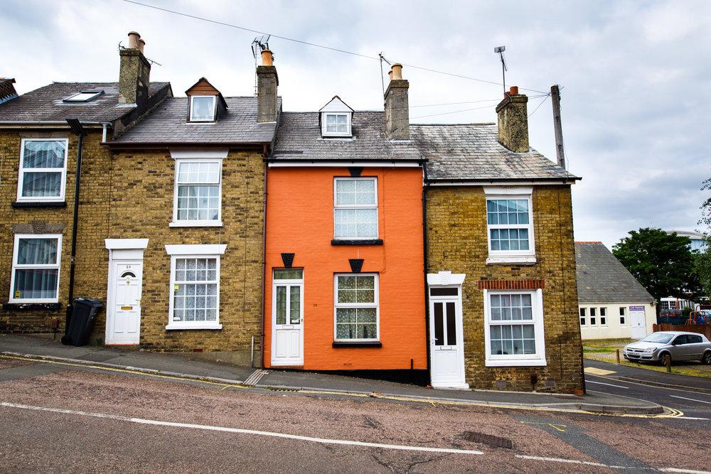 Orange house on a slant.