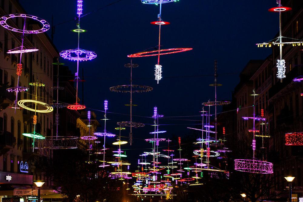Christmas lights hanging above Rue du Mont-Blanc.