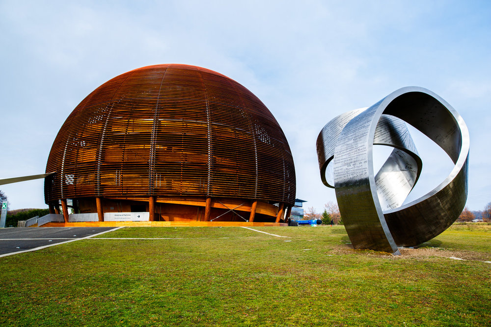 We kicked off day three with a visit to CERN. Pictured is the  Globe of Science and Innovation and a  sculpture by Gayle Hermick .