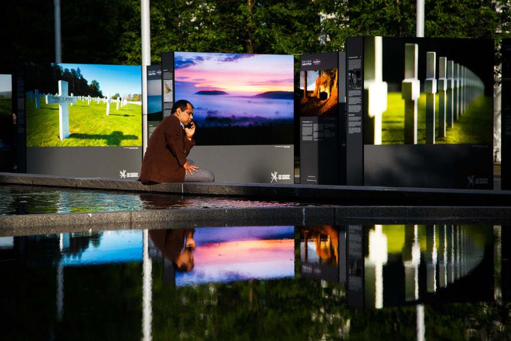 Monthly Digital Splash competitions gave me themes to focus on to go out and photograph - 'Street' was the theme when I saw this man on his phone in front of an outdoor photography exhibition...