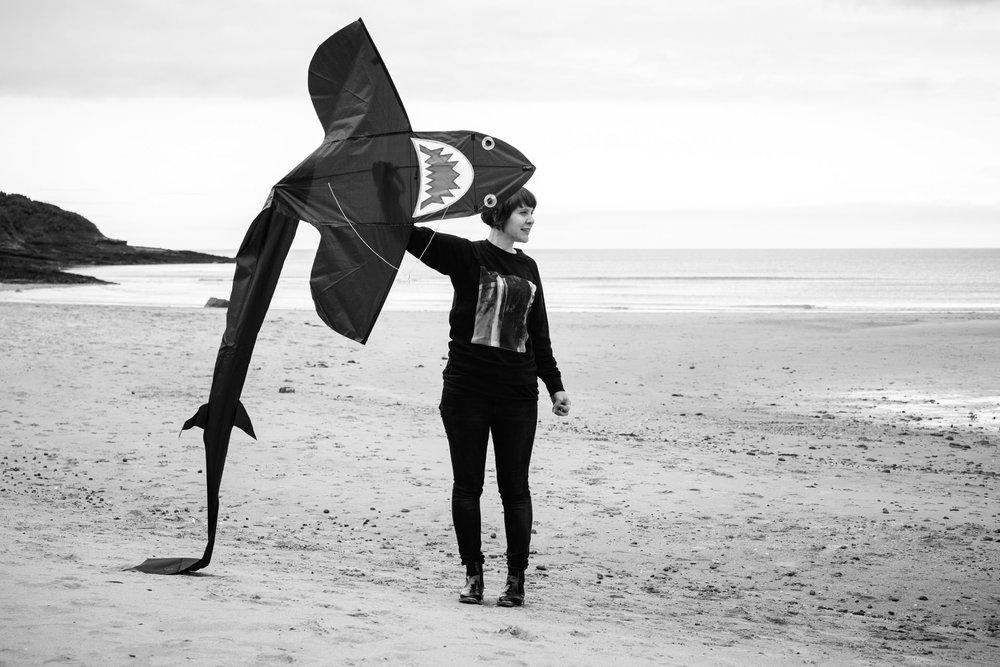 Hannah and her shark kite (she loves sharks!).