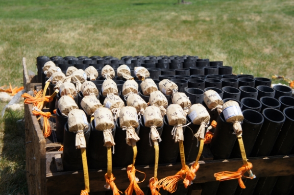Shells get wired and prepped before being dropped in the pipes.