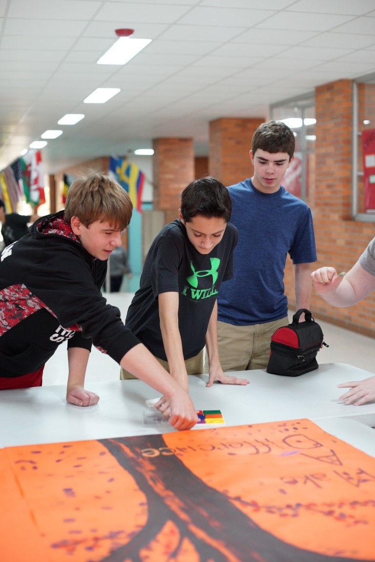 "Jefferson Middle School students add their thumbprint to the ""Make A Difference Tree"", pledging to make a difference through positive thoughts, words and actions. November 2015"