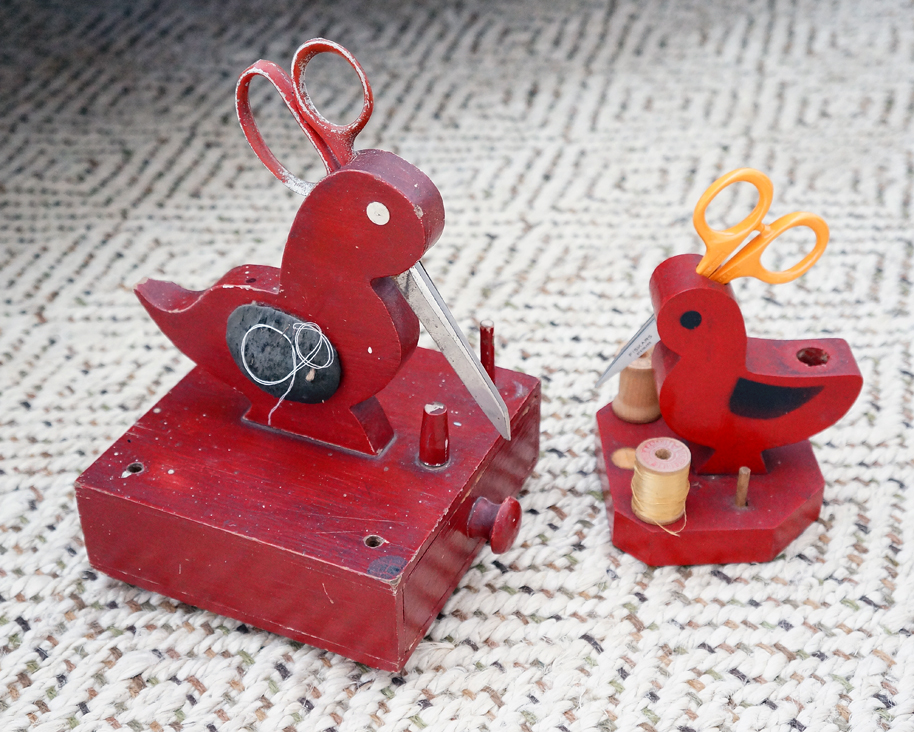 red painted sewing birds