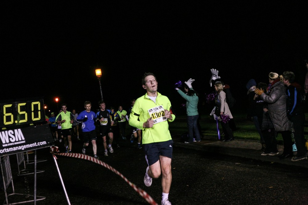 Life Style Sports Run in the Dark Belfast Stormont November 2013. The aim of the run in Belfast is to support the Mark Pollock Trust's mission to fast-track a cure for paralysis. Event created by Piers White.