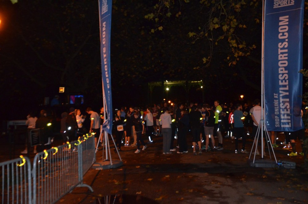 Life Style Sports Run in the Dark London Battersea park November 2013. The aim of the run in London is to support the Mark Pollock Trust's to fast-track a cure for paralysis. Event created by Piers White.