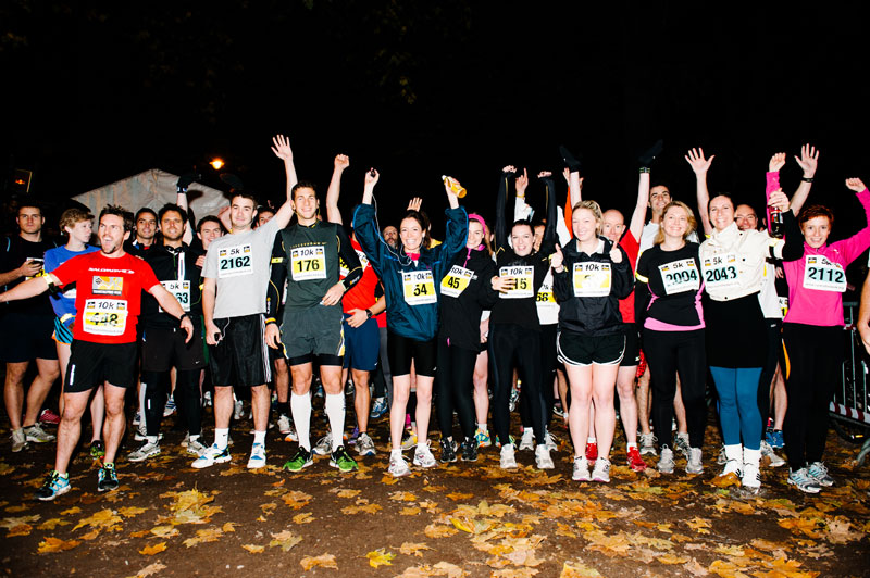 Life Style Sports Run in the Dark London Battersea park November 2012. The aim of the run in London is to support the Mark Pollock Trust's to fast-track a cure for paralysis. Event created by Piers White.