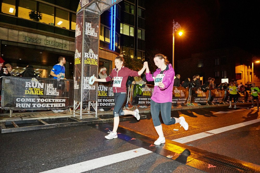 Life Style Sports Run in the Dark Dublin 2014. The aim of the run in Dublin is to raise funds for the Mark Pollock Trust and connect people worldwide to fast-track a cure for paralysis.
