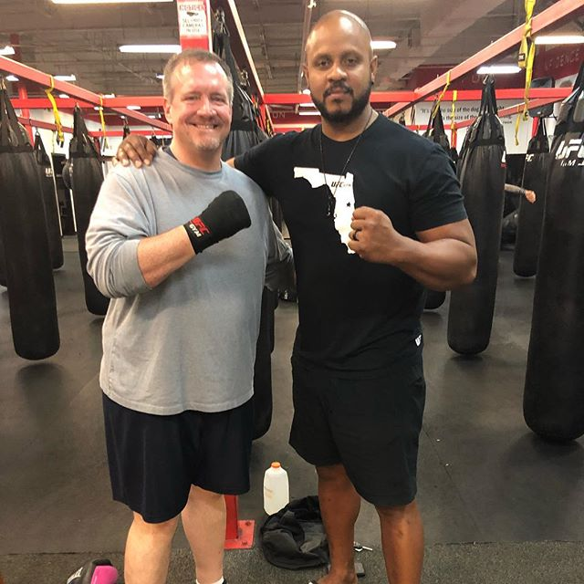 Checking in with coach Steve @fighter1378 celebrating the victory of our team's collective weight loss of more than 30 pounds and performance improvements across the board. @ufcgymwintersprings #ufcgymwintersprings #martialarts #taekwondo #trust #family #feelingwhole #grizzlybear #traindifferent #hardwork #boxing #kickboxing