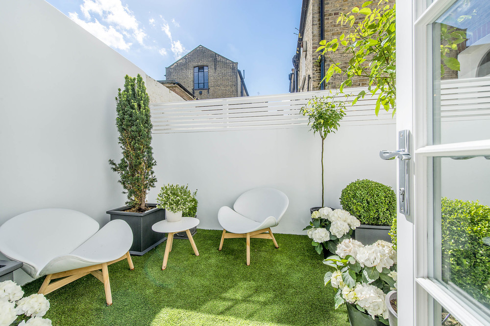 Kicking of with one of our own projects. We love the simple use of colour in this small but lively London courtyard. With the white walls and furniture reflecting the light it becomes the perfect sun trap!
