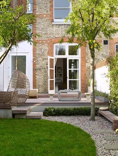 Pinned from plascontrends.co.za. The gravel and stonewashed furniture gives this spacious garden a really natural feel, whilst the sharp lines of the decking and the lawn satisfy out love of precision. We could definitely spend an afternoon chilling out here!