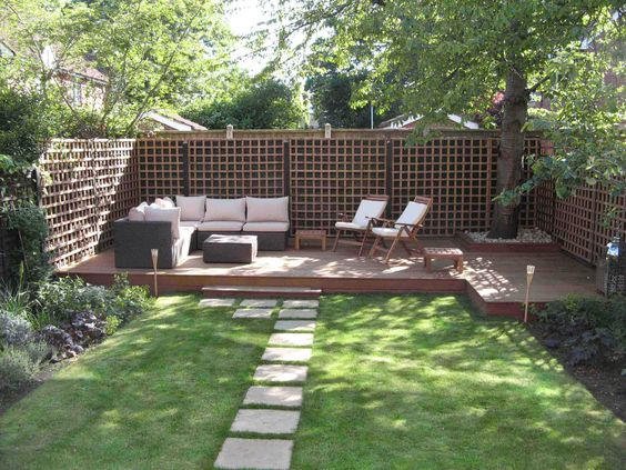Pinned from INTERIORDESIGNINSPIRATION.NET.  The low decking gives this simple garden a stylish elegance that would be perfect for entertaining. We particularly love the addition of a raised bed to frame the tree.