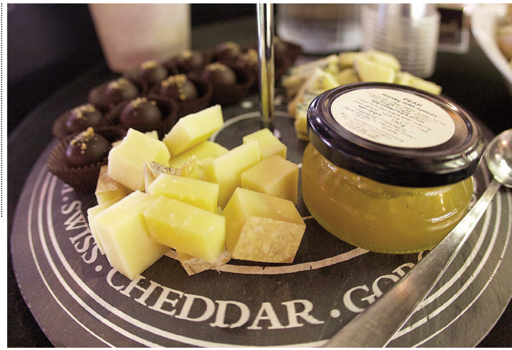 Duplessis sheep's milk cheese, Geai Bleu cheese, pear and honey compote and Kanata maple dark chocolates at Les Gourmands cheese and chocolate shop in Moncton Photo: Victoria Dekker
