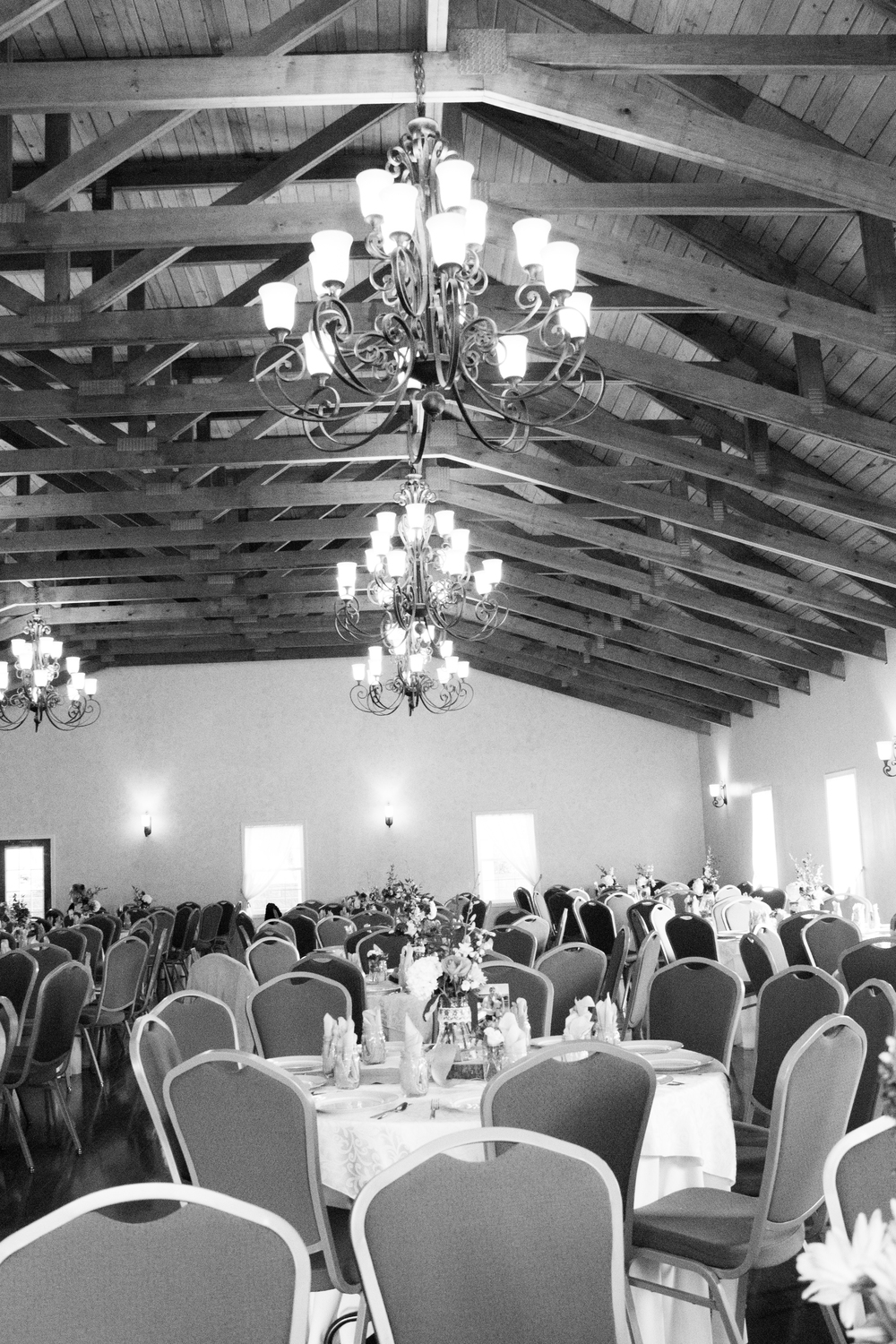 The exposed beams & chandeliers are to die for..