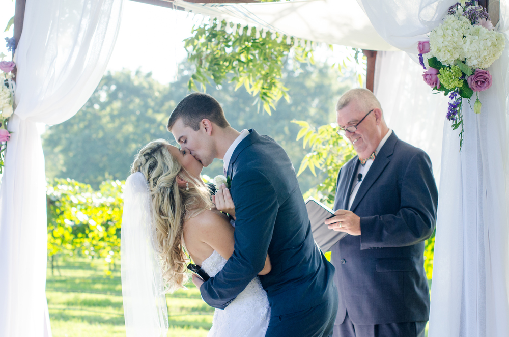 The couple had to wait a very long time for this first kiss, the officiant was teasing the couple a little bit to see how long they could hold out. Jeremy took full advantage of the moment when it finally happened!