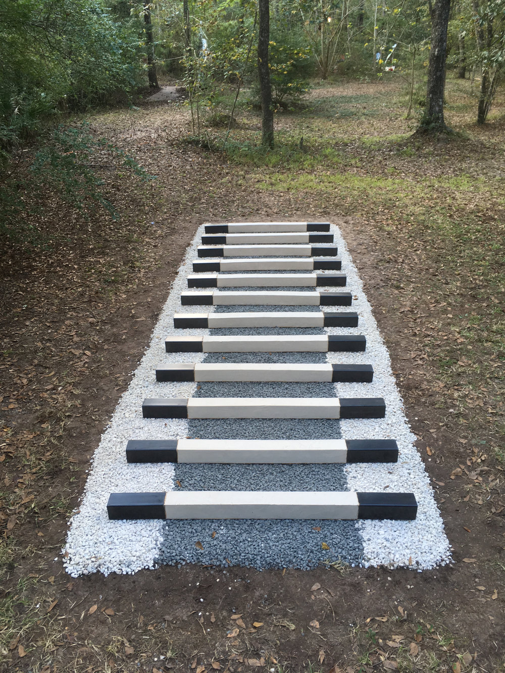 "Trey Duvall Navigation Towards The Closed Horizon, 2016 Unfired Porcelain Clay, Steel, Gravel 6""x8'x22'"