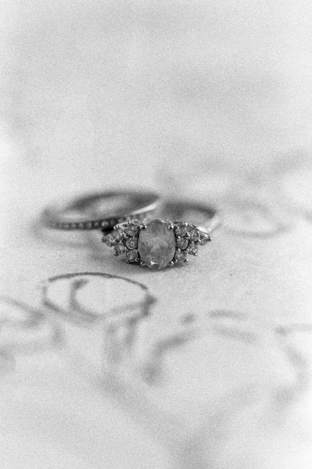wedding-details-rings-bands-christine-gosch-film-photographer-black-and-white-houston-texas-wedding-venue-35mm-photography-fine-art-1.jpg