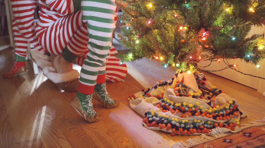 Decorating the Christmas Tree in Christmas Pajamas