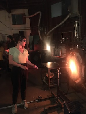 Me blowing glass at the glory hole. That's what it's called, a glory hole.