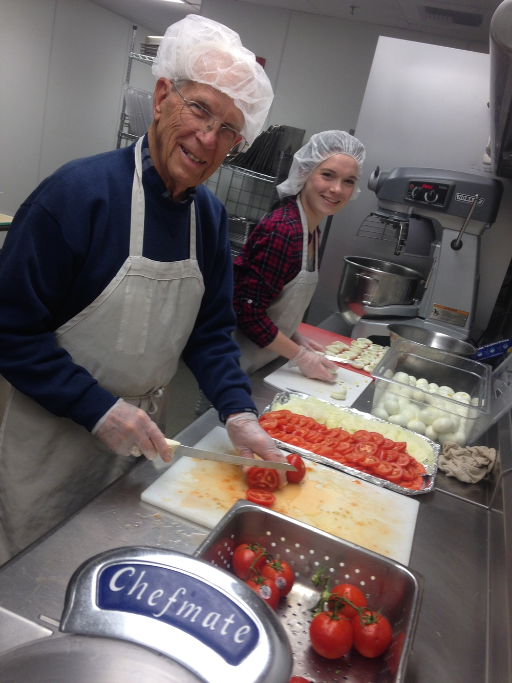 Faith in Action team members dish up smiles and great food at Tacoma Rescue Mission's Adams Street facility.