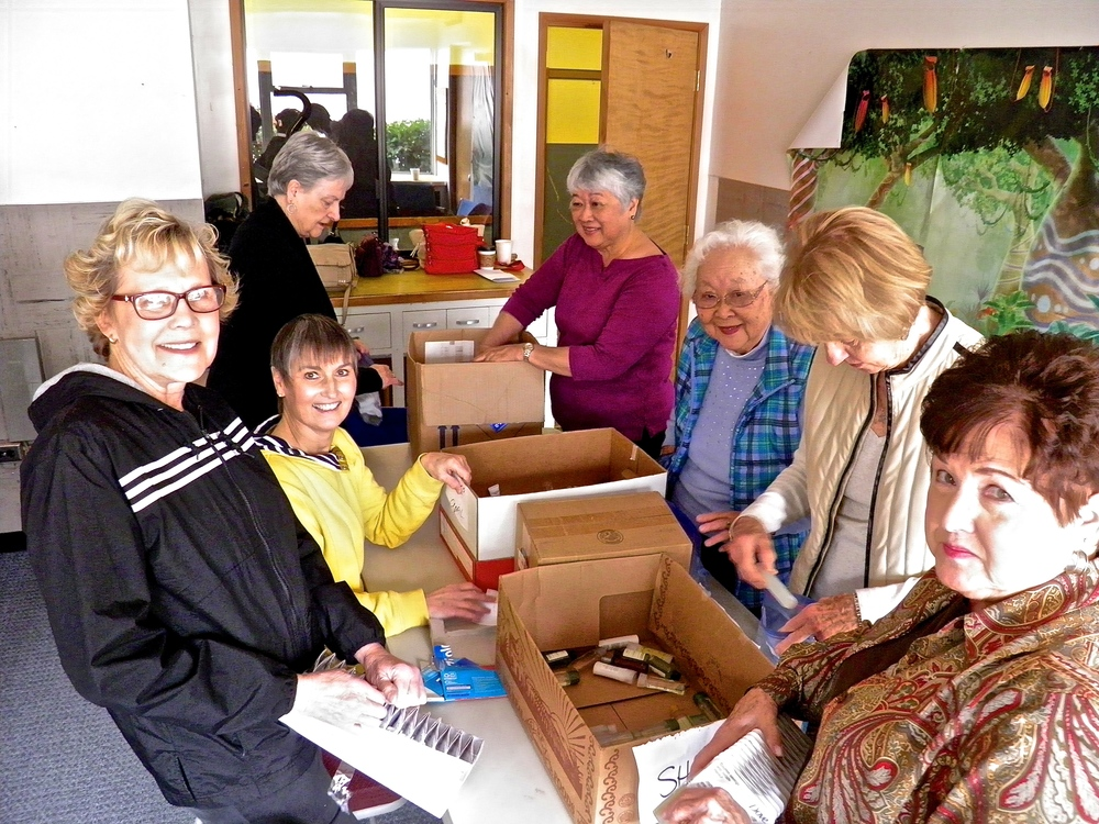 Women assemble hygiene kits for homeless men, women, and children.