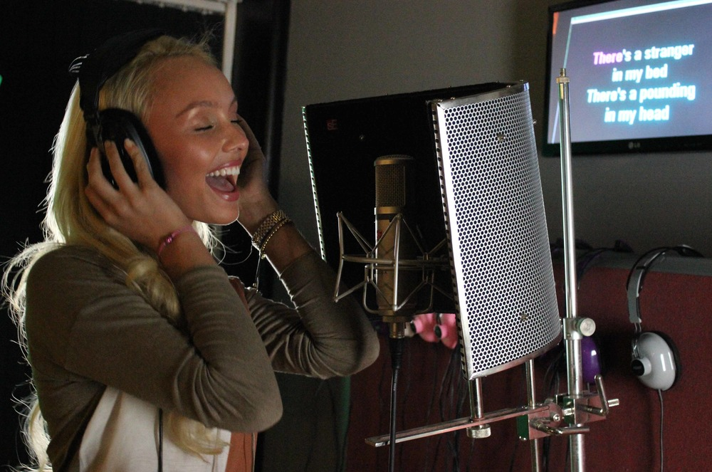 girl-singing-in-studio