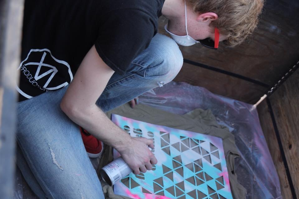 Spray painting shirts at the Gathering. 6/4