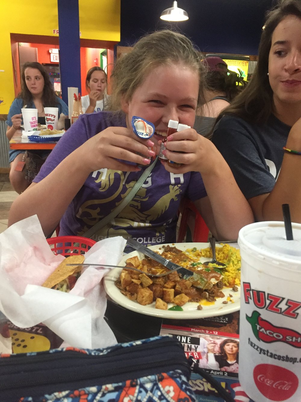 Abby at Fuzzy's with her hot sauces