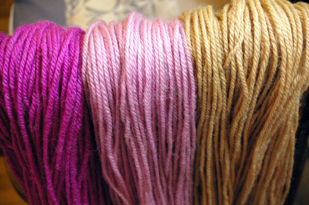 The yarn in the centre is a second dyeing from the solar dyeing jar.