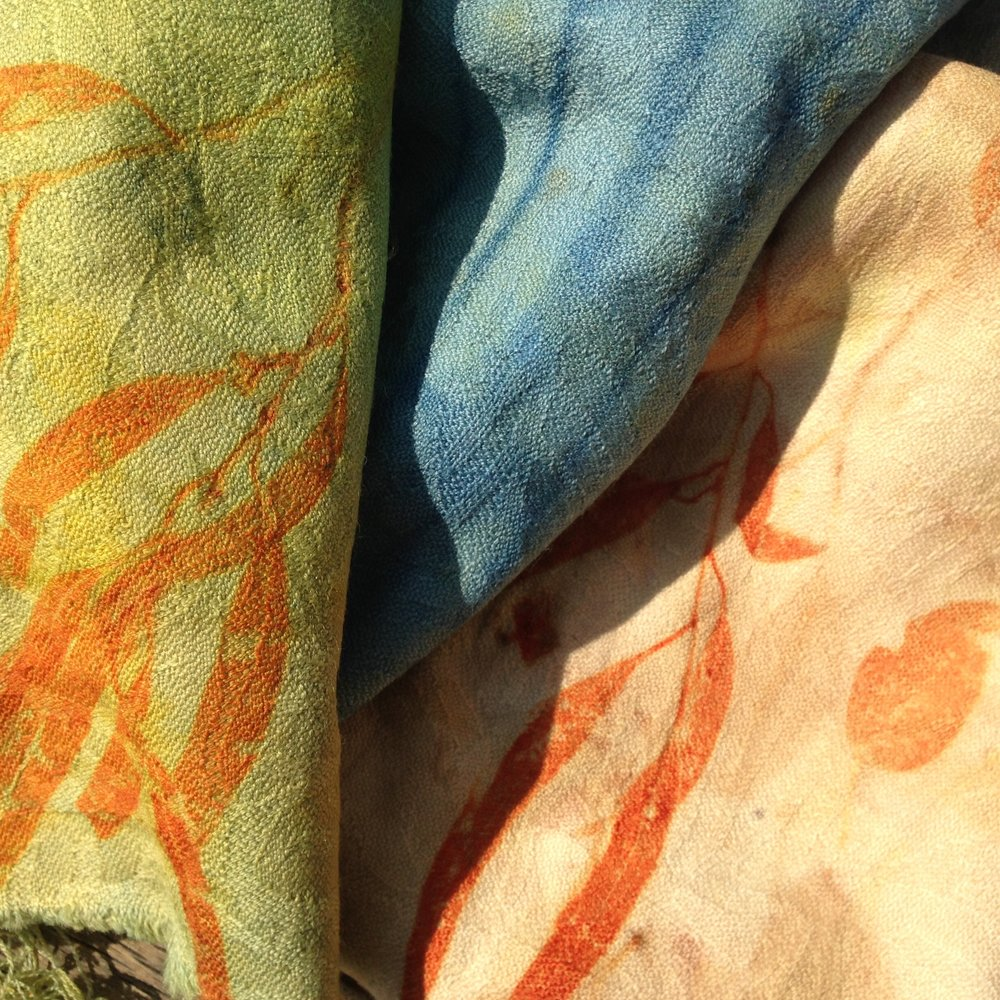 A collection of printed fabrics, over dyed with Turmeric, Ballart cherry and indigo.