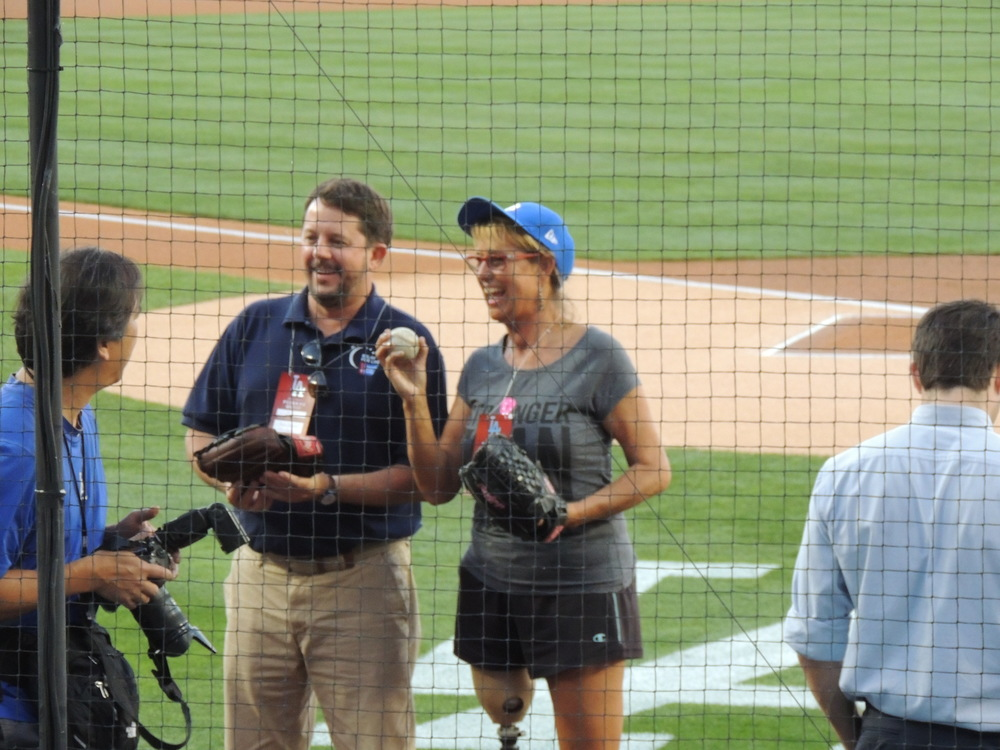 The LA Dodgers and theAmerican Cancer Society invited Adrienne Slaughter to toss the Ceremonial 1st Pitch at the May 1, 2015 Dodgers game at Dodger Stadium. AsAmerican Cancer Society's 2015 Hero and Voice of Hope , she successfully threw the baseball tohome plate.